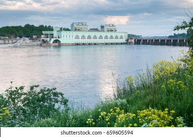 VOLKHOV, RUSSIA - JUNE 03, 2016: Summer landscape with a view of the Volkhov hydroelectric station in the evening