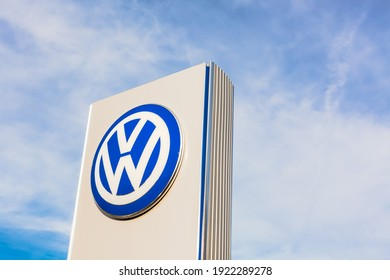 Volkswagen brand logo on bright blue sky background located on its dealer office building in Lyon, France - February 23, 2020