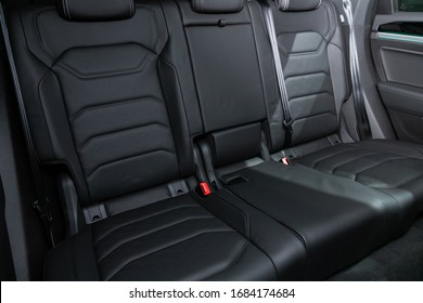 Volkswagen Touareg - black textile  interior design, car passenger and driver seats with seats belt. Novosibirsk, Russia – March 09, 2020.