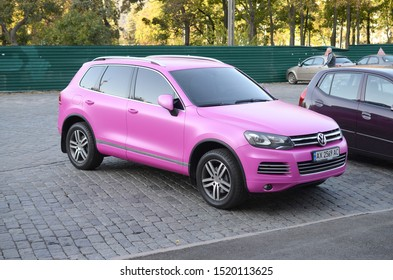 Volkswagen Touareg Hybrid NF in magenta purple color on parking place