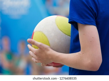 Volleybal in the hands of a child, selective focus