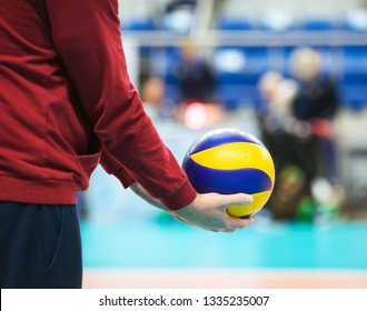 Volleyball ball is in the hands of the coach