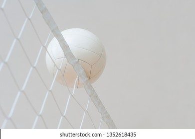 Volleyball ball over the net during match