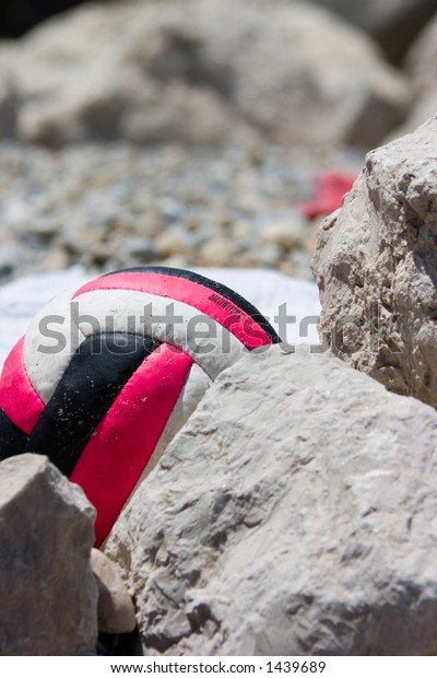 Volleyball behind the rocks on the beach..abstract.