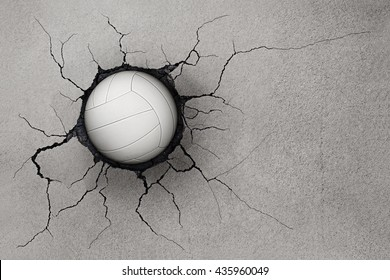 Volleyball damage to the wall with cracks.White ball on the wall