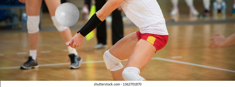 volleyball game sport with group of girls indoor