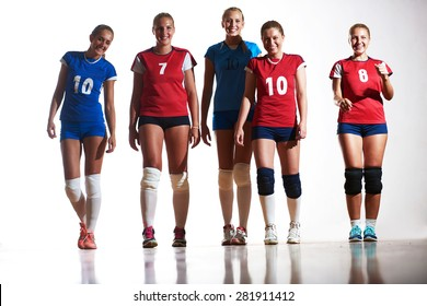 volleyball game sport with group of young beautiful  girls indoor in sport arena ball net