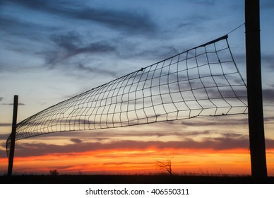 Volleyball net on sunset sky background in the desert