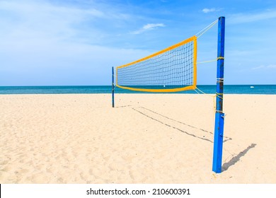 Volleyball net on the tropical beach with blue sky