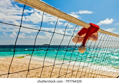Volleyball net with Santa hat is on an island in the Indian Ocean, Maldives