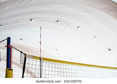 Volleyball net in a warm inflatable hangar in winter.