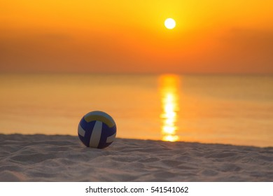 Volleyball  on the  beach at sunset time