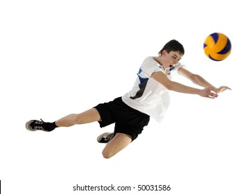 Volleyball player in high flying with a ball ?n the white background