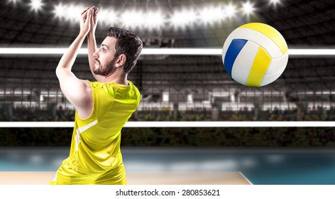 Volleyball player on yellow uniform on volleyball court