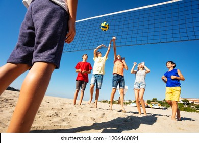 Volleyball players during match on the beach