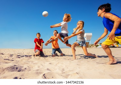 Volleyball players making a bump pass on the beach