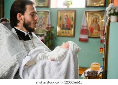 Volodymyr, Volyn / Ukraine - September 09 2018: The ceremony of christening the little girl at church