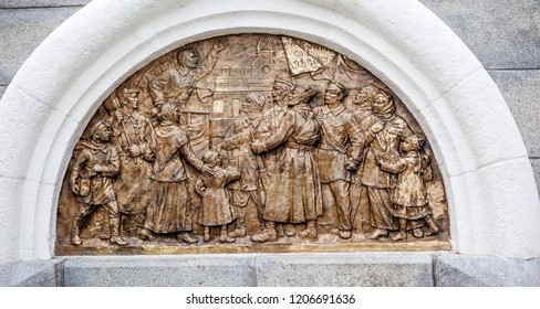 VOLOGDA, RUSSIA - AUGUST 03, 2018: Photo of The bas-relief on the south side introduces the period of the proclamation of Soviet power. Fragment of the monument to the 800th anniversary of Vologda