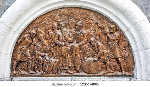 VOLOGDA, RUSSIA - AUGUST 03, 2018: Photo of Northern bas-relief introduces the life of ancient Vologda. Depicts the famous bargaining at the wooden church of the Resurrection of Christ.