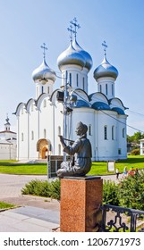 VOLOGDA, RUSSIA - AUGUST 03, 2018: Photo of The sculpture of the muse in the image of a peasant girl on the background of the St. Sophia Cathedral. Kremlin Square.