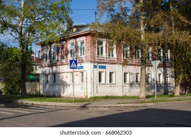 VOLOGDA, RUSSIA - AUGUST 15,2016: Wooden house with carved polisade. Russian traditional architecture lies in wooden houses with manually carved decorations, often painted in white