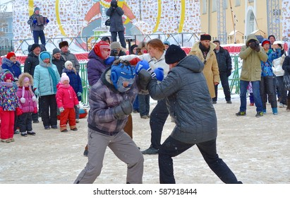 Vologda, Russia - February 23, 2017: Russian man on the square in a traditional Russian fun - fisticuffs during Shrovetide celebration.