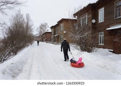 Vologda, Russia - January 30, 2016: People walking on snowy street in old russian city Vologda, snowfall