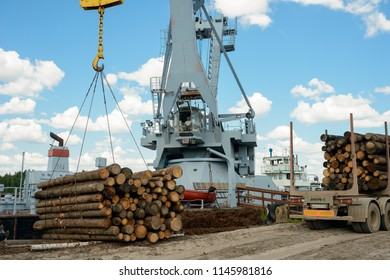 Vologda, Russia - july 17, 2018: Heavy lifting crane is ready to load wooden logs. Industrial cargo crane at a port. Logging and transportation of wood