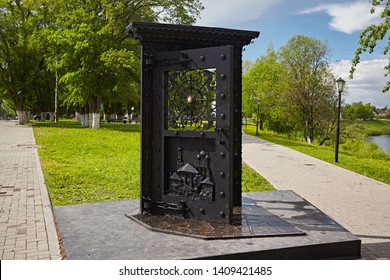 Vologda, Russia - July 2018:  Sculpture of metal door, the opening of the city of Vologda
