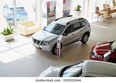 Vologda, Russia - June 18, 2019: Cars in showroom of dealership Nissan in Vologda city in Russia. Top view