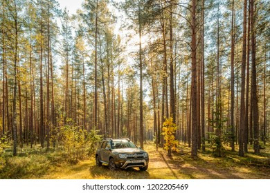 Volova Gora, Belarus - October 6, 2018: Car Renault Duster SUV in autumn forest landscape. Duster produced jointly by French manufacturer Renault and its Romanian subsidiary Dacia.