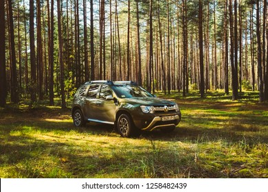 Volova Gora, Belarus - October 6, 2018: Car Renault Duster SUV in autumn coniferous forest landscape. Duster produced jointly by French manufacturer Renault and its Romanian subsidiary Dacia.