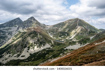 Volovec, Ostry Rohac and Placlive mountain peaks with Dolne Jamnicke pleso lake on Rohace mountain group from hiking trail near Derava hill in Zapadne Tatry mountains in Slovakia