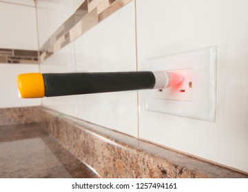 voltage detection on electric receptacle in the kitchen, voltage indicator turning red when 110 volts or more are present.