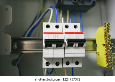 Voltage switchboard 220 volt, electrical cables with  modern circuit breakers are  in the ON position in the  electric box and ground copper bar. Electrical background.