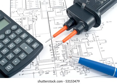 Calculator pen on electrical diagram stock photo edit now 53153482 voltage testercalculator and pen on electrical diagram ccuart Image collections