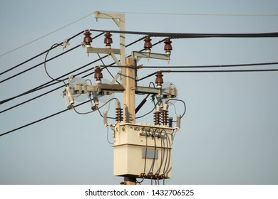 Voltage transformer. High voltage current transformer before supplying electricity to houses in the village