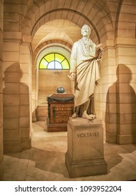 Voltaire's tomb and statue in the crypt of the Pantheon in Paris
