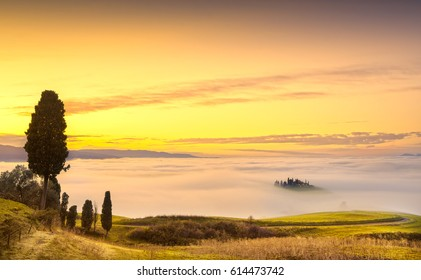 Volterra fog and sea of clouds, rolling hills panorama on sunset. Tuscany, Italy, Europe