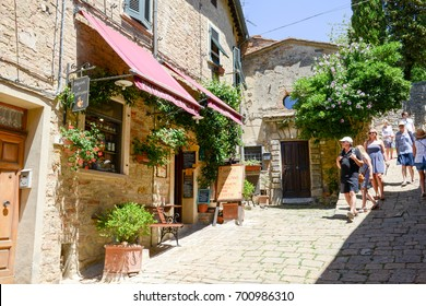 Volterra, Italy - 6 July 2017: people visiting and walking the old town of Volterra on Tuscany, Italy