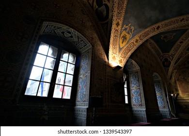 "Volterra / Italy - Febraury 19 2019: interiors of the decorated room of the City hall ""Sala del Maggior Consiglio"""
