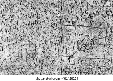 Volterra, Italy - September 2016: A mysterious series of symbols are scratched into the courtyard walls, the work of former patient Oreste Ferdinand Nannetti in Psychiatric hospital. Volterra, 2016