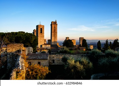 Volterra panorama at sunset. View of the medieval towers and the rural landscape