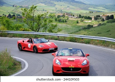 VOLTERRA (PI), ITALY - MAY 17: Two red Ferrari 430 Scuderia spider take part to the 1000 Miglia Ferrari Tribute on May 17, 2014 near Volterra (PI).