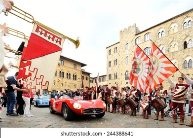 VOLTERRA (PI), ITALY - MAY 17: A red Maserati 300 S Fantuzzi, followed by a blue Porsche 356, takes part to the 1000 Miglia classic car race on May 17, 2014 in Volterra (PI). Both cars built in 1955.