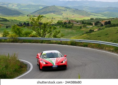 VOLTERRA (PI), ITALY - MAY 17: A red Ferrari 458 Speciale take part to the 1000 Miglia Ferrari Tribute on May 17, 2014 near Volterra (PI). The car has the hood painted with Italian flag colors.