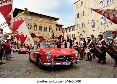 VOLTERRA (PI), ITALY - MAY 17: A red Mercedes 300 SL W 198, followed by a red Maserati 150, takes part to the 1000 Miglia classic car race on May 17, 2014 in Volterra (PI). Both cars were built in 55.