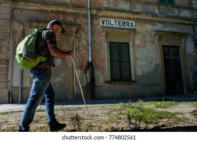 Volterra, Pisa, Italy - November 1, 2017: Hikers depart from Saline for the Volterra hills with panoramic views across the old railway