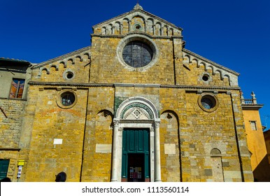 VOLTERRA, PISA, ITALY - September 27, 2015: Facade of the Duomo of Volterra the ancient cathedral of Santa Maria Assunta the architectural style is Romanesque and Baroque.