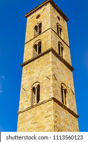 VOLTERRA, PISA, ITALY - September 27, 2015: Bell tower of the Duomo of Volterra the ancient cathedral of Santa Maria Assunta is in Romanesque style.